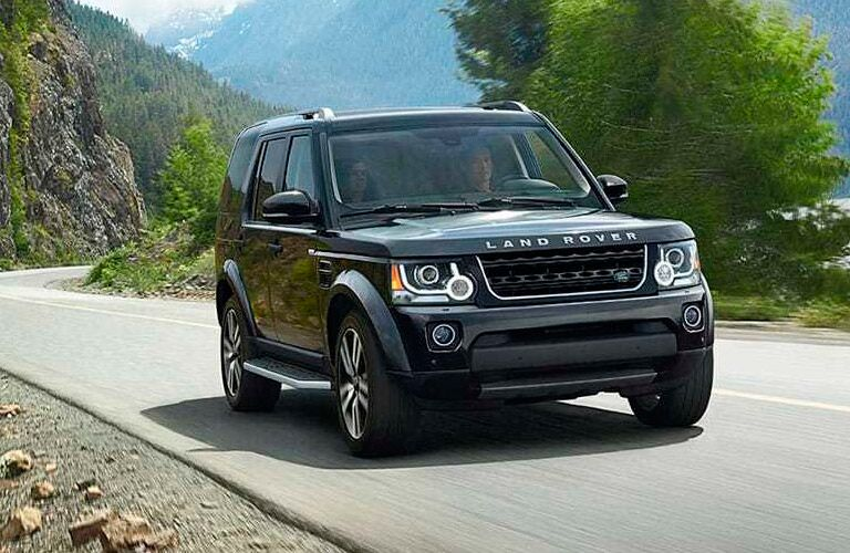2017 land Rover driving on a winding mountain road