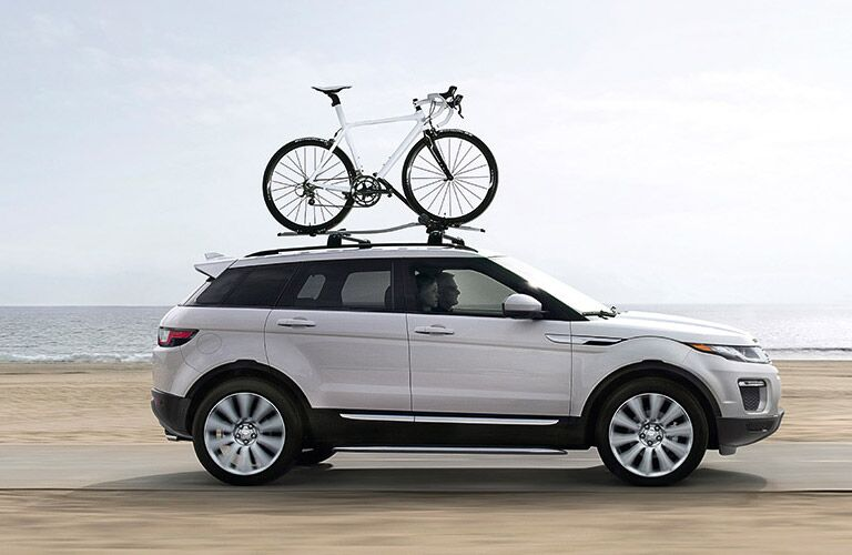 2017 Range Rover Evoque in white with a bike strapped to the roof rack