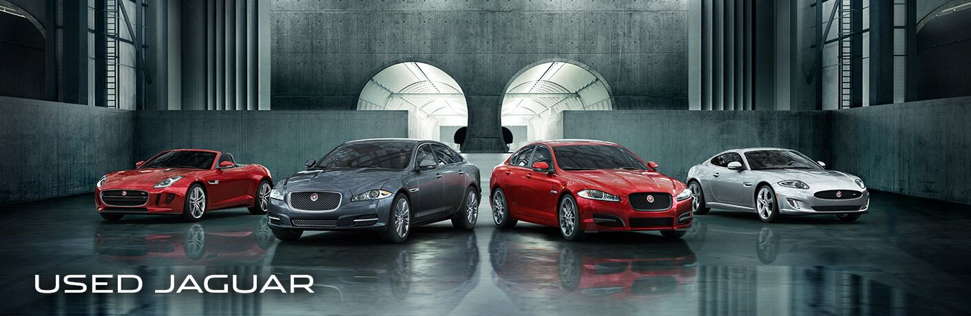 four Jaguar models lined up in a modern concrete room with the words Used Jaguar