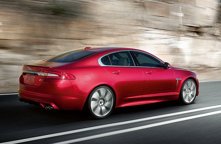 Side profile of a red Jaguar sedan
