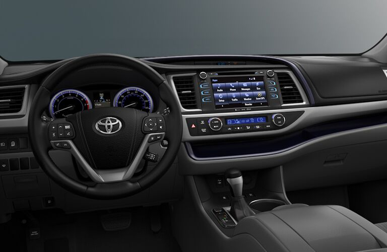 Dashboard and steering wheel inside the 2018 Toyota Highlander