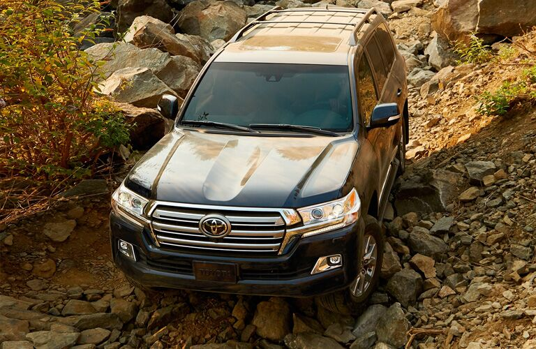 2019 Toyota Land Cruiser driving on a rocky path