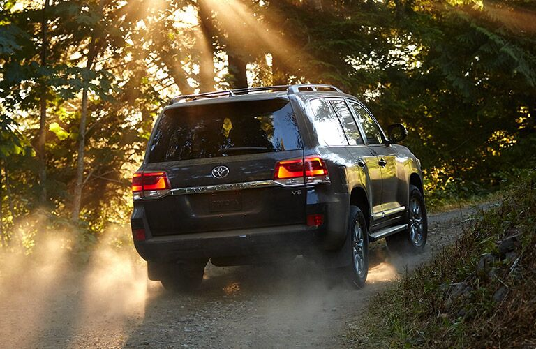 2019 Toyota Land Cruiser driving on a dusty trail