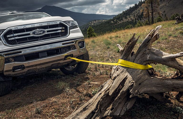 2020 Ford Ranger with a tow line on a branch