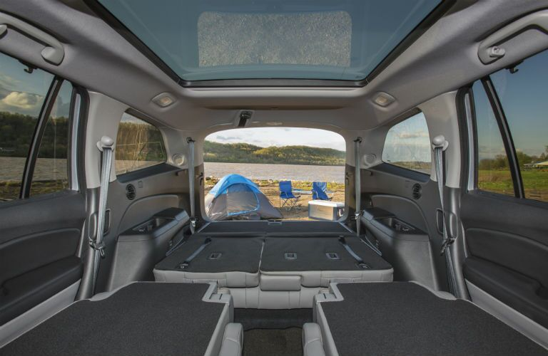 Looking out the rear of the 2018 Honda Pilot with both rows a rear seats folded flat