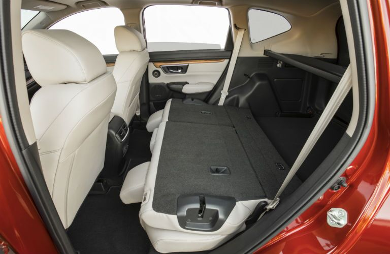 Side view of the 2018 Honda CR-V's rear seat folded flat for storage