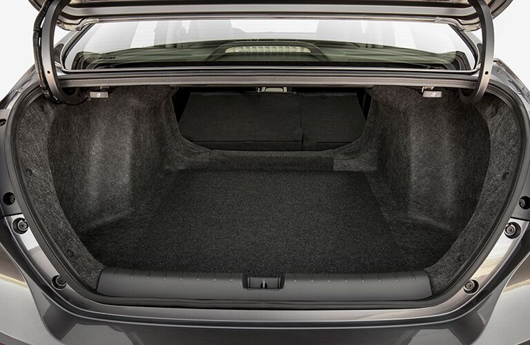 Looking into the open and empty trunk of the 2019 Honda Insight