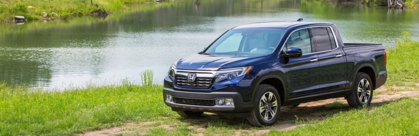 2020 Honda Ridgeline parked in front of stream from exterior drivers side