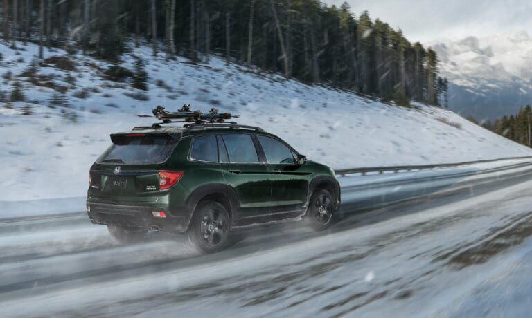2021 Honda Passport driving through snow
