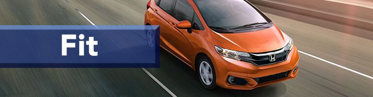 orange 2019 Honda Fit with banner