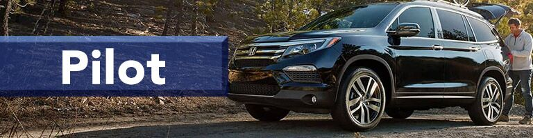 black 2019 Honda Pilot with banner