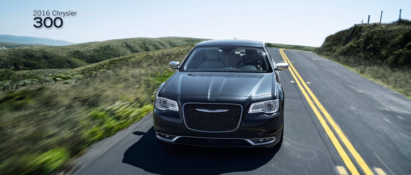 2016 chrysler 300 driving front view on road