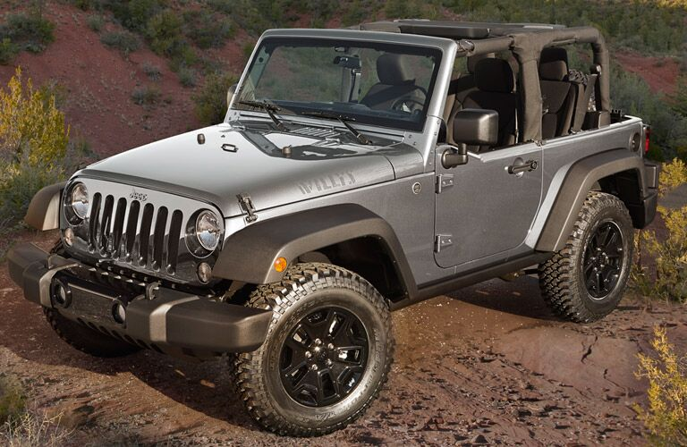 2016 Jeep Wrangler parked on dirt