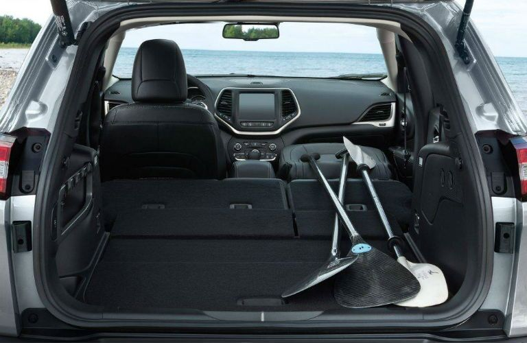 cargo area with paddles inside of Jeep Cherokee