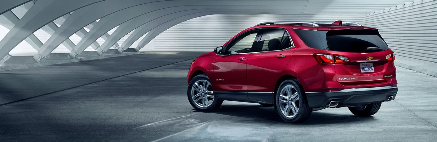 red chevrolet equinox in white room