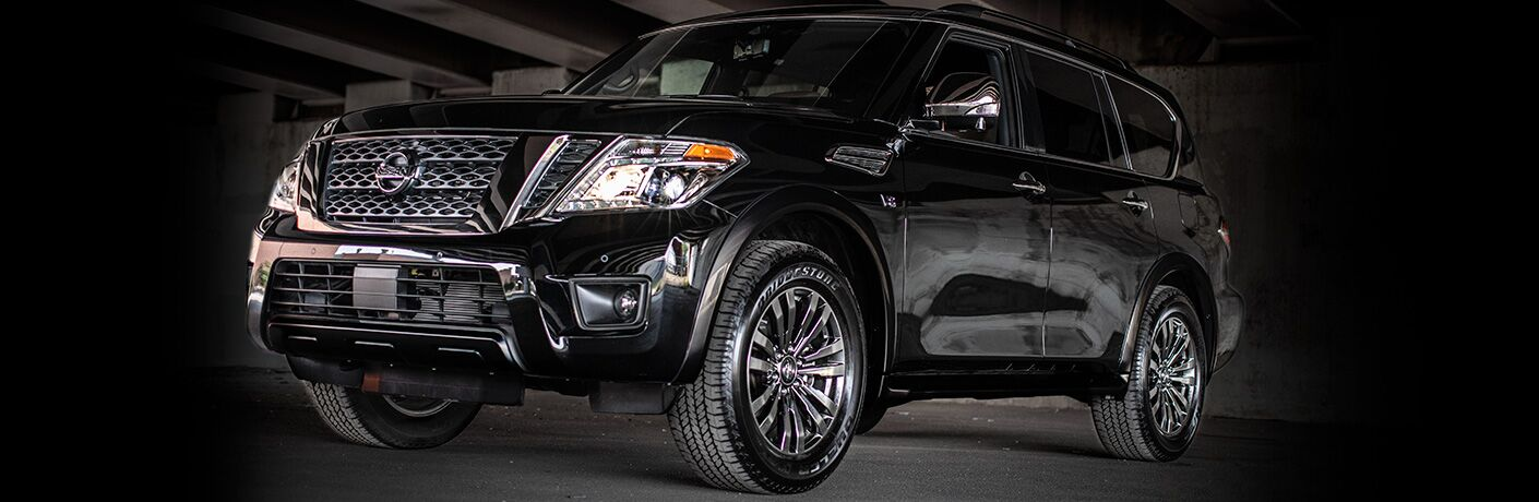 black 2019 nissan armada on black background