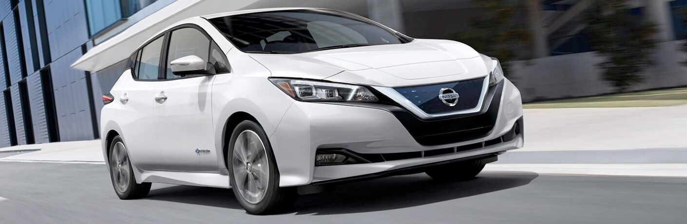 white Nissan LEAF side front view