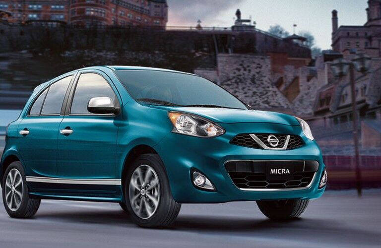 teal 2019 Nissan Micra ® in a city