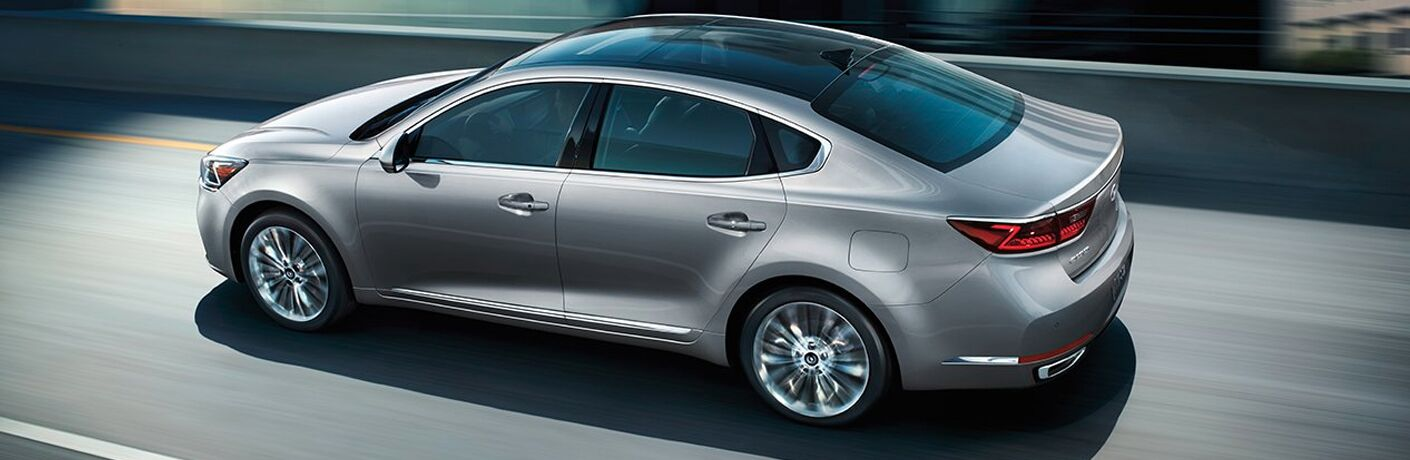 right side view of gray kia cadenza driving
