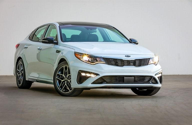 2020 Kia Optima parked in front of white wall from exterior front