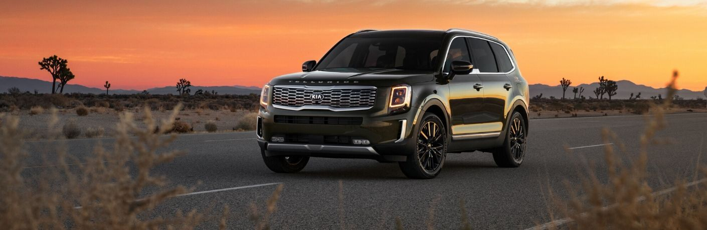 2020 Kia Telluride driving with the sunset in backgroun