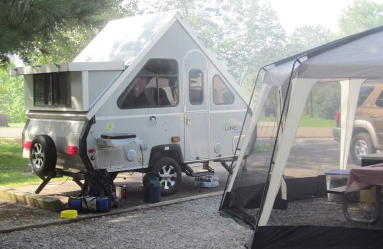 Aliner camper by tent