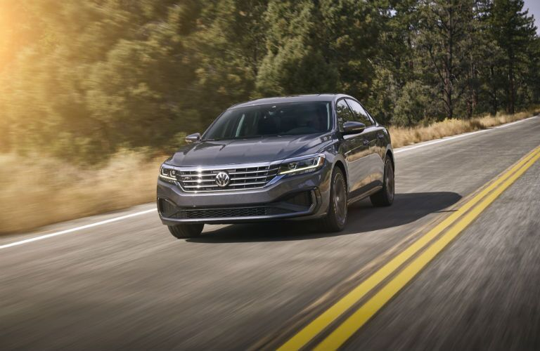 2020 VW Passat exterior front fascia and drivers side going fast on road