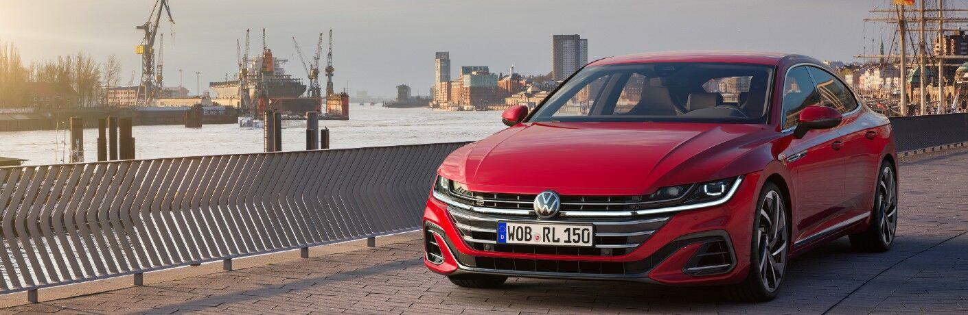 red 2021 Volkswagen Arteon driving through a city