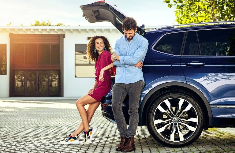 couple near the rear of the 2021 Volkswagen Tiguan