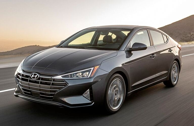 silver 2019 Hyundai Elantra front view on road