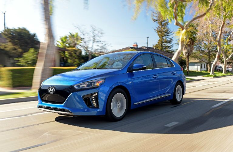 blue hyundai ioniq driving on road
