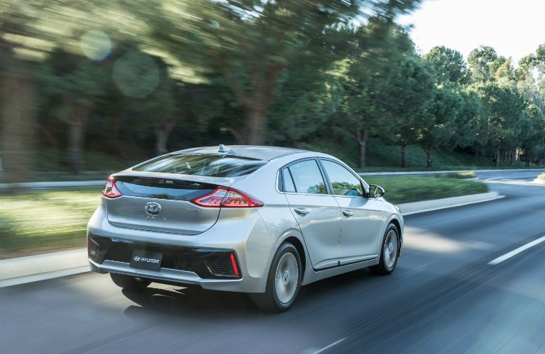 silver hyundai ioniq driving on road