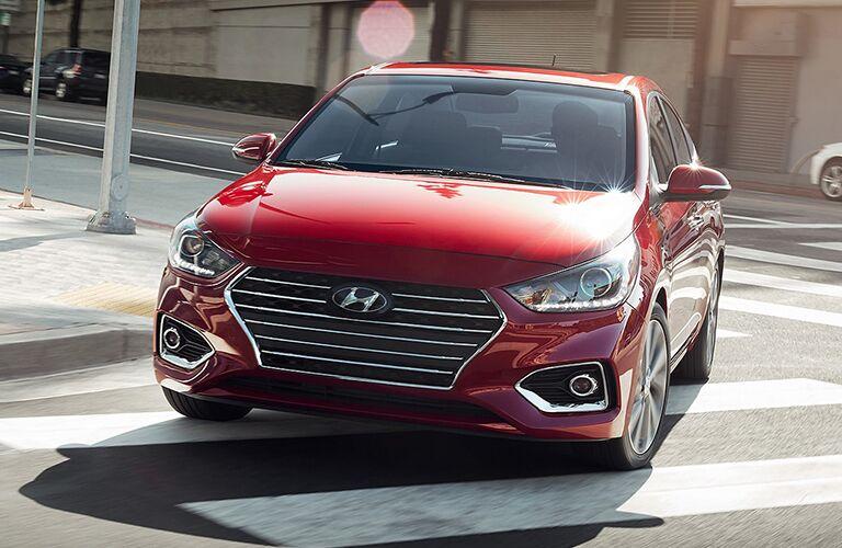 red 2019 Hyundai Accent turning a corner
