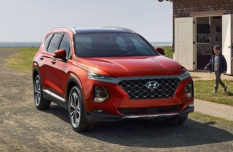 orange 2019 Hyundai Santa Fe in a driveway