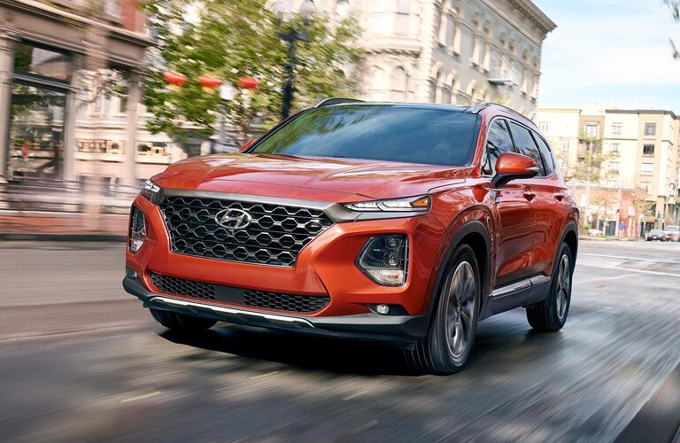 orange hyundai santa fe front view