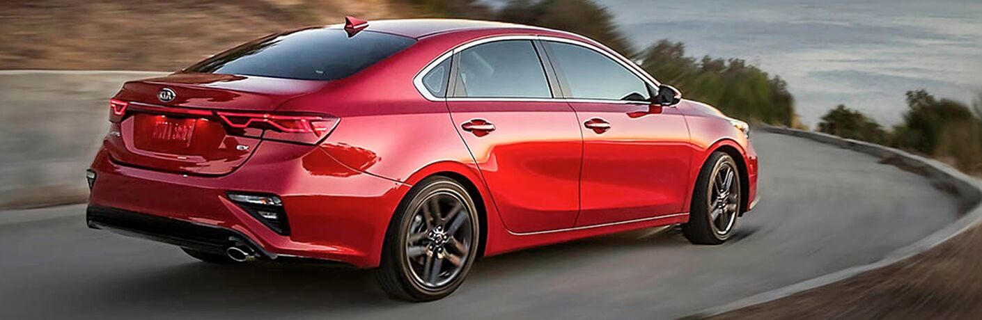 2019 Kia Forte red driving down highway road
