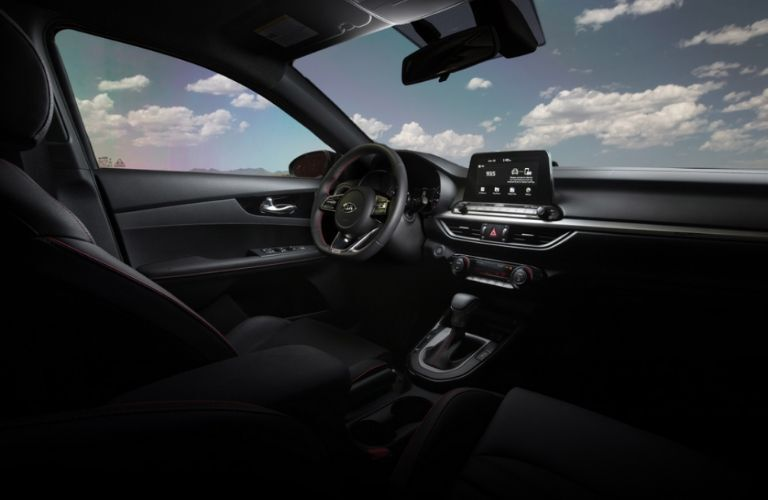 Interior view of the front seating area inside a 2020 Kia Forte