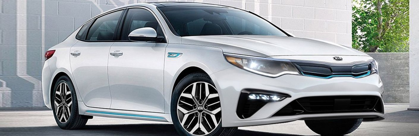 Exterior view of a white 2020 Kia Optima Hybrid