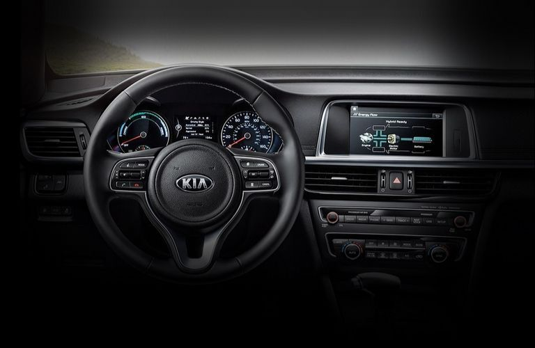 Interior view of the steering wheel and touchscreen inside a 2020 Kia Optima Hybrid