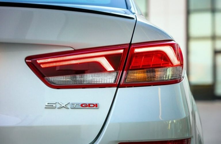 Exterior view of the brake light and SX T-GDI badging on a white 2020 Kia Optima