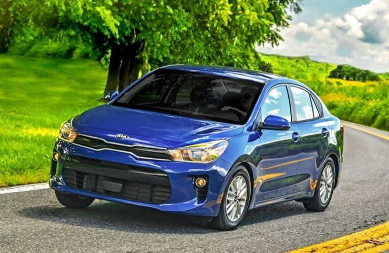 Exterior view of the front of a blue 2020 Kia Rio