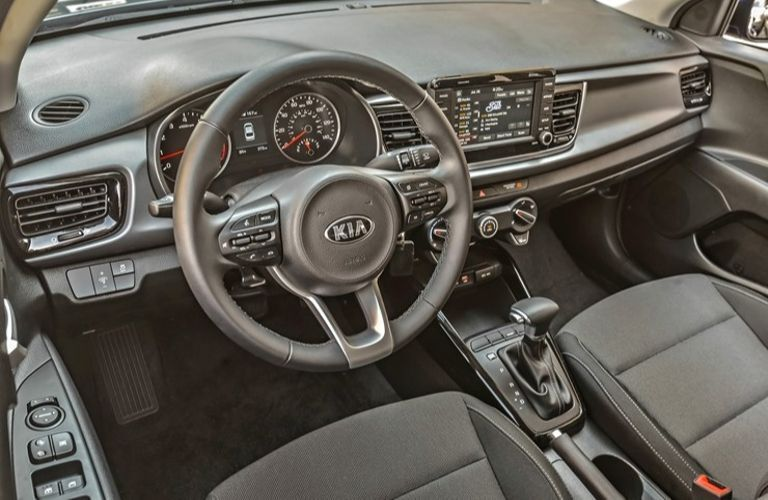 Interior view of the front seating area inside a 2020 Kia Rio