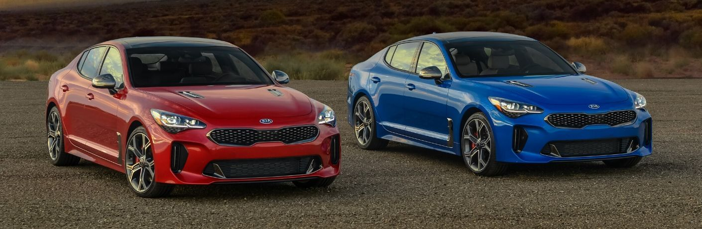 Exterior view of two 2020 Kia Stinger models, one red and one blue.