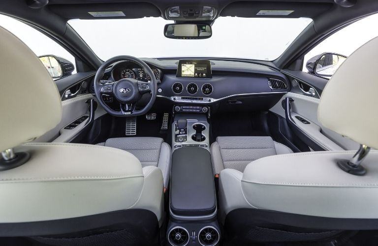 Interior view of the front seating area inside a 2020 Kia Stinger