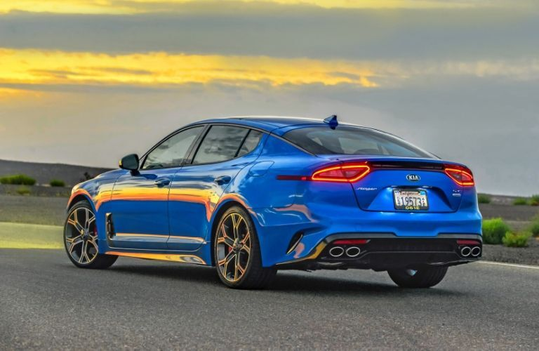 Exterior view of the rear of a blue 2020 Kia Stinger