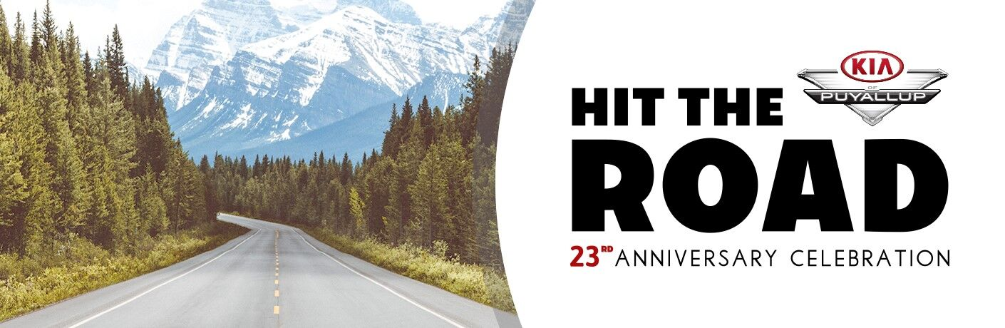 Hit the Road 23rd Anniversary Celebration header image with road going through woods