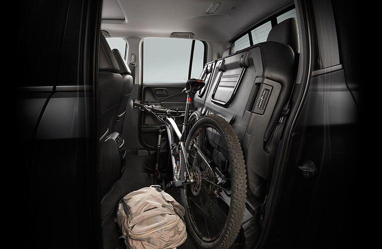 Ridgeline folding rear seat