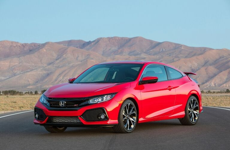Red 2019 Honda Civic Si Coupe Front Exterior on a Desert Highway