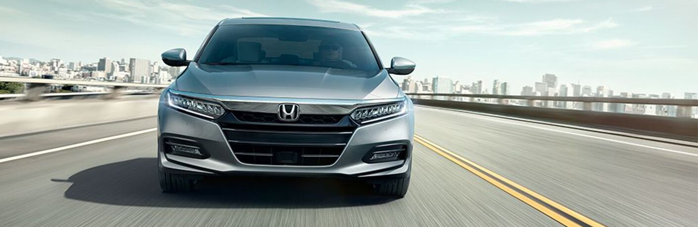 head-on view of 2018 Honda Accord grille with city skyscrapers in background