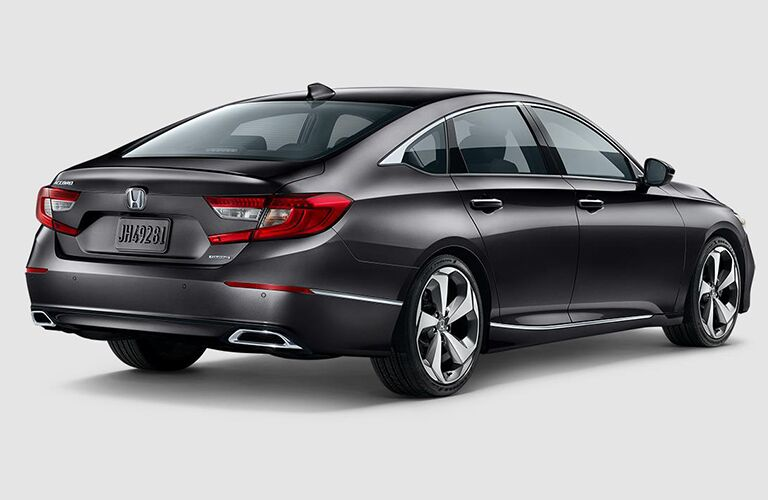 rear side view of silver 2018 Honda Accord on white background